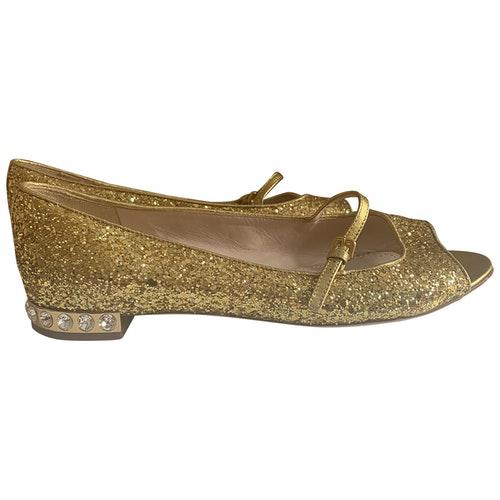Shop Miu Miu Gold Glitter Flats